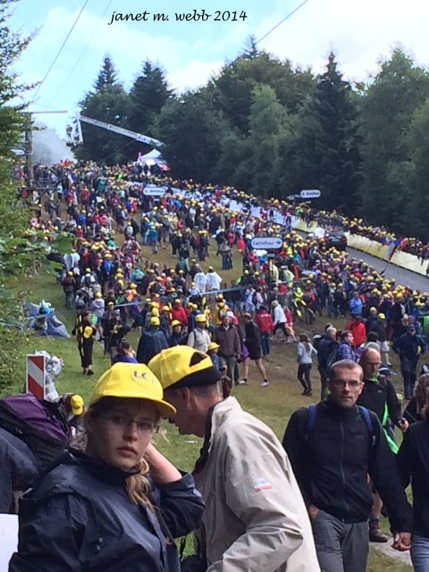 A bit of the crowd and, in the background, riders going up that 22% grade.